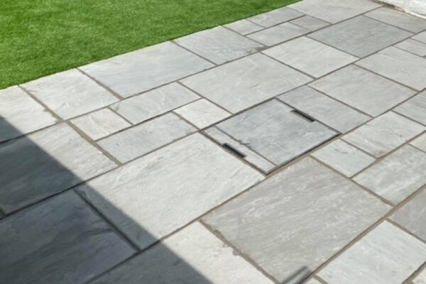 Modern Flagstone Patio with artificial grass