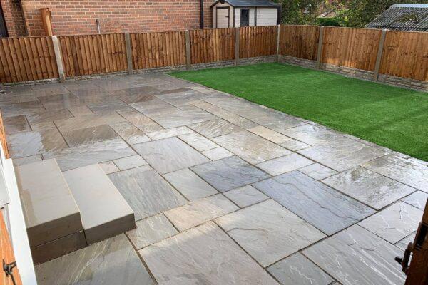 Modern Garden with a stone paving patio