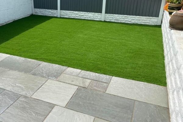 Modern Stone Patio with artificial grass