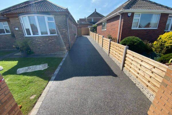 Modern tarmac driveway entrance